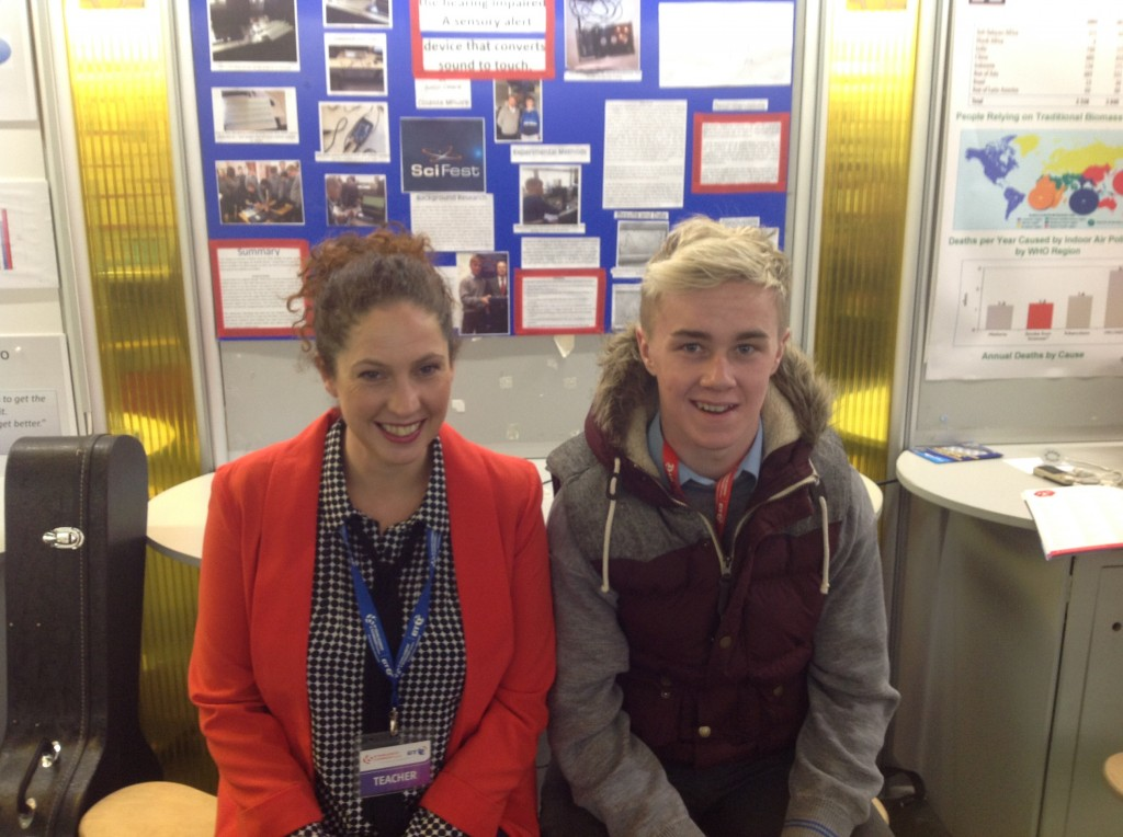 Representing Coláiste Mhuire Johnstown in the Senior Cycle entries @ BT Young Scientist 2015 is LCA student Justin Cleere with Ms Valerie Bergin (Science teacher)