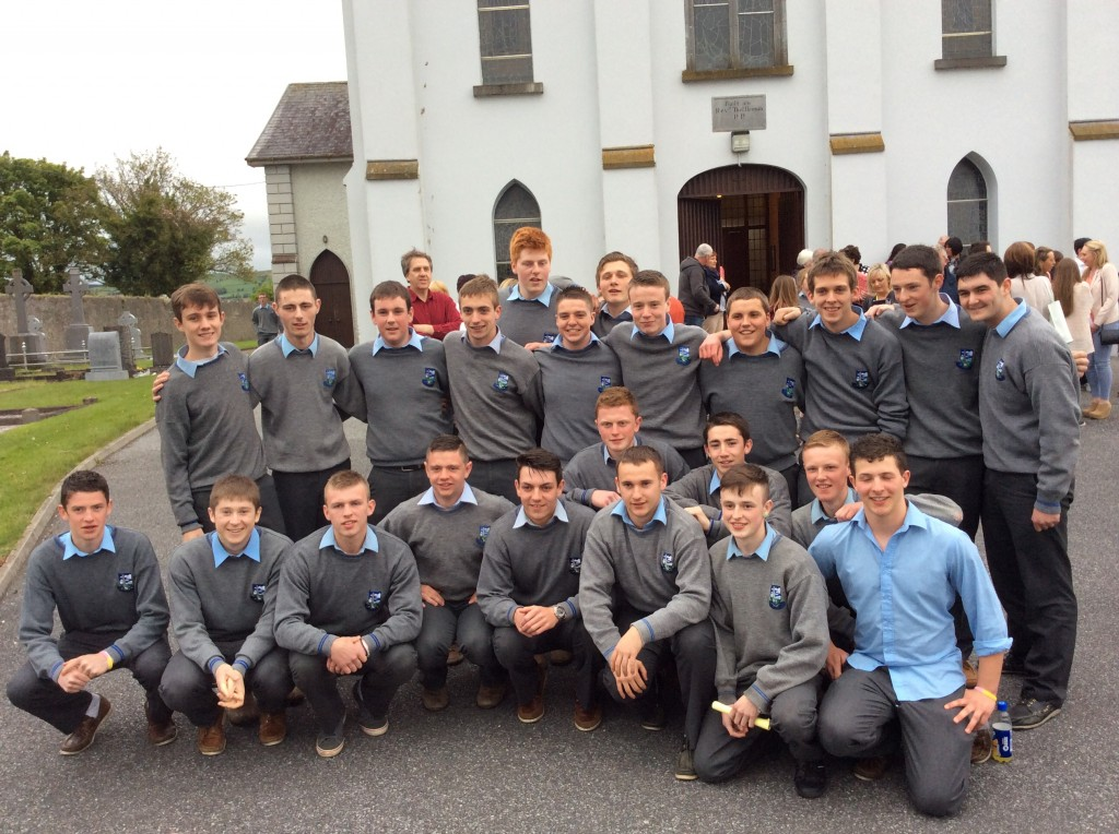 Some Leaving Cert Boys from Colaiste Mhuire outside church in Johnstown