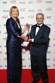 Tomi Reichental receiving his International Person of the Year Award 2014 from RTE's Eileen Dunne